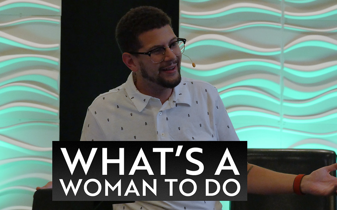 """Pastor Jacob preaching his message What's a Woman to Do. Green lit backdrop and white, wavy tiles are in the background. The words """"What's a Woman to Do?"""" on the bottom third of the image."""